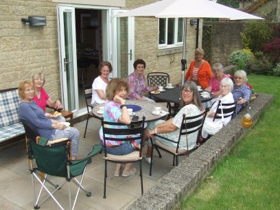 Enjoying tea, cakes and chat